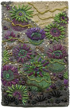 """Tidepool exploration. The sea anemone tentacles are made with straight stitches and some couched threads. Beads and French knots represent limpets and small rocks and shells. This is my impression of the green and purple anemones (aggregate anemones) scattered about the coast of BC, Canada. Marine life provides a huge wealth of inspiration for the textile artist. SOLD 3"""" x 4 1/2"""" 9"""" x 11"""" framed www.chursinoff.com/kirsten"""