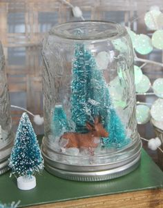 DIY Waterless Snow Globes - globes:   •Wide Mouth Pint Jars•Glass Cruets   •Artificial Snow•Miniatures of Your Choice •Hot Glue Gun & Glue