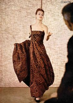 1960 Model in one shouldered printed silk evening gown by Jules Crahay for Nina Ricci