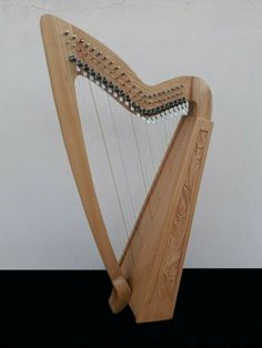 22 strings harp with semi tone levers. 3 course harp, plays from – Birch ply sound board & Ash ply back. Made from selected Ash wood. Ash wood carving & inlay done by hand. Stainless steel pins & semi tone levers for tuning. Birch Ply, Irish Celtic, Harp, Wood Carving, Book, Ebay, Wood Sculpture, Books, Book Illustrations