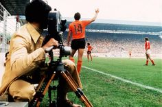 A cameraman films Holland's Johan Cruyff as he calls for the ball, 1974
