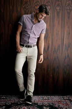 This combination of a purple gingham short sleeve shirt and nude chinos is perfect for off-duty occasions. Tap into some David Gandy dapperness and complete your look with black low top sneakers. Shop this look on Lookastic: https://lookastic.com/men/looks/purple-gingham-short-sleeve-shirt-beige-chinos-black-low-top-sneakers/16936 — Purple Gingham Short Sleeve Shirt — Beige Chinos — Black Low Top Sneakers
