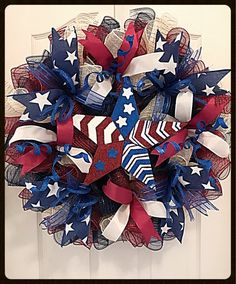 Celebrate all Patriotic Holidays with this Americana Star Deco Mesh Wreath. It is made with high quality burgundy, navy and cream deco mesh. There are burlap star ribbons, glittered blue ribbons with silky burgundy and cream ribbons. Blue flex tubing and glittered blue spring picks have been Mesh Ribbon Wreaths, Christmas Mesh Wreaths, Burlap Wreaths, Yarn Wreaths, Floral Wreaths, Door Wreaths, Prim Christmas, Christmas Ribbon, Wreath Crafts