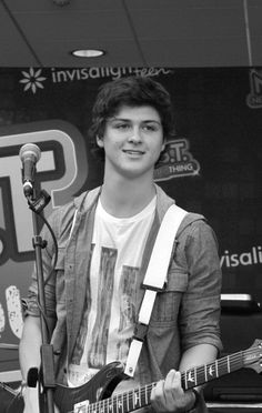 """Cameron Byrd is a senior in high school who has had dreams of being in a band since he was 8 years old. After formerly playing with another band, he joined Hollywood Ending as the band's guitar player/vocalist. You can hear Cameron in all of Hollywood Ending's songs and he even takes the lead vocals in their latest song, """"Famous"""". He always has a smile on his face while playing and is super sweet to the fans. Cameron is an extremely talented musician that is widely loved by fans!"""