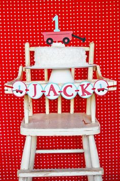 Modern Red Wagon -- perfect set-up for a first birthday with the smash cake topper and high chair banner by http://pinwheellane.etsy.com