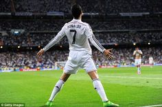 Ronaldo strikes a typical pose after scoring his third and Real's fifth goal...