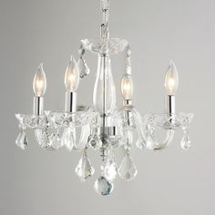Crystal Mini Chandelier in 7 colors: Clear, Sapphire Blue, Turquoise, Strawberry Red, Black, Purple and White: 16 inches wide by 12 inches high with 6 inches of chain.  From my friend Walter at shadesoflight.com in Virginia.