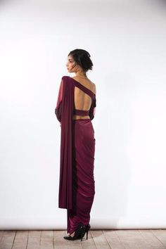 Wine three piece sari with a one-shouldered silk blouse with beading silk straight pants and a pre-stitched jersey sari drape. Hand-embroidered with tone-on- Indian Attire, Indian Wear, Indian Dresses, Indian Outfits, Indian Clothes, Saree Jackets, Look Short, Stylish Blouse Design, Indian Blouse