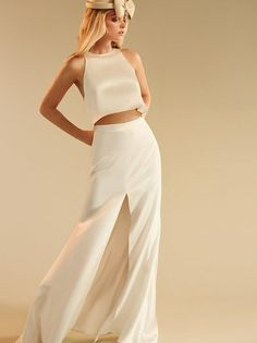 Who says you can't get married in a crop top? This is a two piece set with a racerback top and a floor length skirt.