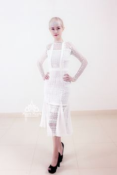 White midi lace dress. Code KH2623  Vintage-inspired lace with a fitted waist and fluted mid-hem skirt. Crochet lace trims. Round neck. Stand crochet collar. Bib bodice. Puffed long sleeves. Single button cuffs. Zip at centre back. Darted box pleat hem at skirt.  #lace #a-line #longsleeves #weddingdress #beautyinwhite Unique quality custom wedding dresses. Ship Worldwide. Each of the dress is created based on each of our client's exact requirements and measurements.  Email: meerameerafashi