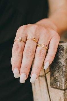 Stacked rings + delicate birthstone details. Two of our favorite things. Birthstone Stacking Rings, Birthstone Necklace, Stacked Rings, Stone Gold, Delicate Rings, Bar Necklace, Personalized Jewelry, Band Rings, Birthstones