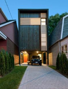 """The """"Shaft House"""", a 1,400 sq ft home built on a 20' wide lot in Toronto, Canada; designed by architect Reza Aliabadi; photo by borXu Design"""