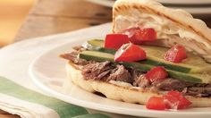 Pork is a tasty variation from lamb in great-tasting gyros topped with garlic mayonnaise.