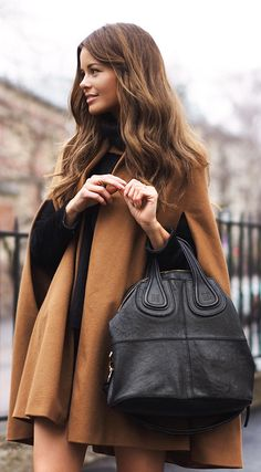 Cape Fashion Trend: Annette Haga is wearing a dark brown cape from Zara
