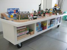 Are your kids drawn to the train table at the bookstore like moths to a flame? It's easy to see why. The low table is a perfect height and the large surface can hold a ton of toys. Before buying a new train table, look around your house to see if you've got the makings of one laying around.