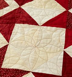 Jo Kramer quilted floral medallions in the blocks.