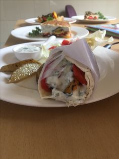 #Souvlaki rolled in #Pita #bread, and served with #Roasted #Potatoes (#Greek #Cuisine)