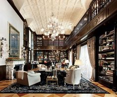 I love this room - the bookshelves, the richness of the wood, the warmth, the coziness.