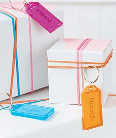 Key Chain as Gift Tag    Add a fun touch to a gift box by using a bright key chain as a tag, attached with big rubber bands in place of ribbon. The recipient will love it, even if it doesn't go with a bow-wrapped Lexus in the driveway.
