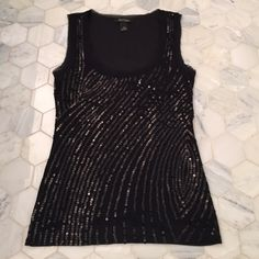 White House Black Market Sequined Top New sequined top. Never worn and super cute! Would look great dressed up or casual! Lined on the inside. Looks great with the apostrophe jacket and Calvin Klein purse in my closet! See the apostrophe pictures for the full outfit! White House Black Market Tops