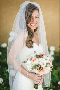 A gorgeous navy and peach DIY wedding in California featuring stripes and navy bridesmaids dresses photographed beautifully by…