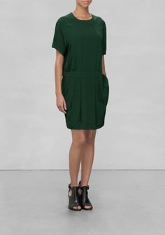 A relaxed viscose dress with a horizontal panel around the waist, and two comfy front pocket to rest your hands.