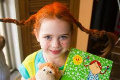 A little Pippi longstocking with her monkey