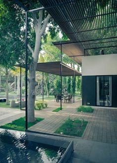 Summer style!! Gorgeous modern contemporary outdoor covered walkways and terrace veranda patio! Love how the trees and water blend right into the building and outdoor area!