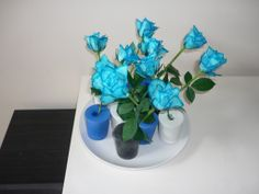 Balloon vases with colored roses - great for table setting at a boys party
