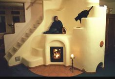 More beautiful cob building. integrating stairs, stove heating, and nooks for lounging or decorative items.