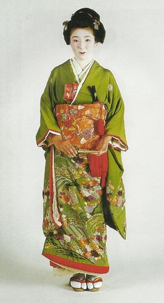 "Scan from book ""The History of Women's Costume in Japan.""  Scanned by Lumikettu of Flickr.  This woman is wearing a furisode and obi dating to about 1775-1850, Japan"
