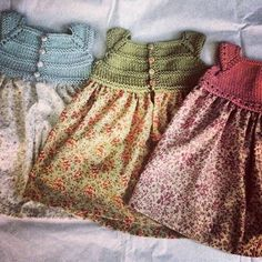 So cute! Knit top and calico skirt. Laura Dress on Ravelry.