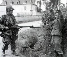 Prisoner of war: German soldier surrending to US Paratrooper, WWII, Normandy. Ww2 History, World History, Military History, World War Ii, Nagasaki, Hiroshima, Vietnam, History Online, Prisoners Of War