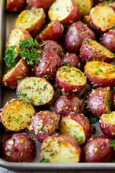 These roasted red potatoes are coated in garlic, herbs and parmesan cheese, then oven baked to golden brown perfection. Potato Sides, Potato Side Dishes, Side Dishes Easy, Vegetable Side Dishes, Side Dish Recipes, Dinner Recipes, Appetizer Recipes, Main Dishes, Appetizers