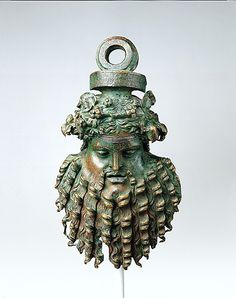 Bronze handle attachment in the form of a mask. Late Hellenistic or Early Imperial 1st century BC - 1st century AD. (25.4 cm)