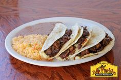 Quesadillas - Three cheese quesadillas served with rice and beans with ...