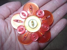 Button flower brooch by gingersquirrel, via Flickr