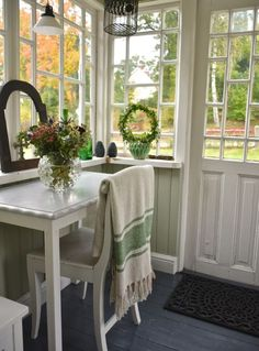 What a cozy little corner on the porch.