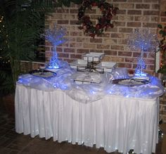 Hordereve table for Christmas party with blue LED underlit organza to create a sophisticated snowy effect.