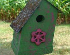 Lime green bird house for home or garden with recycled rustic metal flower warm industrial cottage simple chic design a perfect nesting place for songbirds in your yard or garden area or bring inside to hang on a wall for spring year round.  Im named The Habit as this reminds mr pete of a nuns covering from his childhood past.  Birdhouse collecting is like woman and there desire for shoes and handbags one is never enough. Unscrew the bottom to clean up after the birdies. simple.  Our houses…
