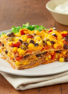 Bean Enchilada Casserole....this Pinterest popular dish is perfect for Meatless Mondays with tortillas, refried beans, diced tomatoes, black beans and Cheddar cheese!
