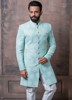 Adorn yourself with this classy sky blue lucknowi sherwani embedded with sequins. Designed with the mandarin collar, full sleeves and the set of beautiful buttons which enhances the overall sherwani's appearance. Mens Indian Wear, Indian Groom Wear, Indian Wedding Wear, Indian Men Fashion, Indian Man, Men's Fashion, Sherwani For Men Wedding, Mens Sherwani, Wedding Men