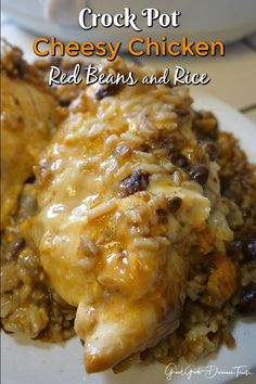 Crock Pot Cheesy Chicken Red Beans and Rice is comfort food at it's best. A hearty, easy meal to prepare, super delicious and a family favorite.