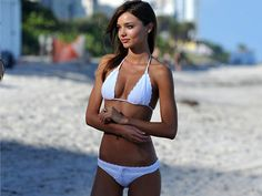 """""""A girl in a bikini is like having a loaded pistol on your coffee table — there's nothing wrong with them, but it's hard to stop thinking about it.""""--Garrison Keller"""