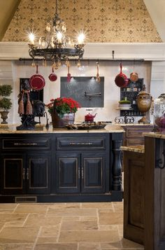 Rustic lower cabinets were treated with the look of a hand-rubbed furniture finish. The bronze accents dress it up, giving the space an Old-World aesthetic.