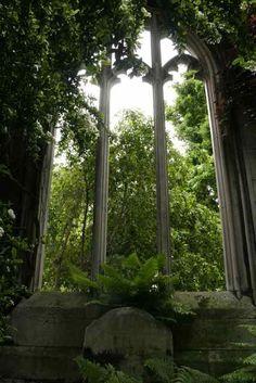 gothic window frame utilized in garden setting