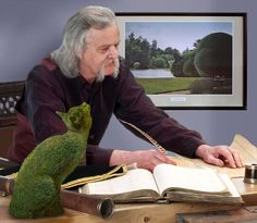 Rich working at his desk:  A fantasy photo collection that is so beautiul.about a topiary lsrger than life cat.  He also paints surrealist works of art.