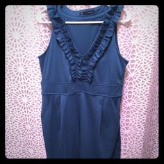 Teal cotton ruffle dress with pockets Nice thick cotton material. Zipper on side. Ruffle down bust and around the neck. Pockets on both sides. 2 pleats under bust at waist. Hits mid thigh. Worn once. I'm a size 16 in picture 4. Maurices Dresses Midi