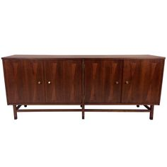 Walnut & Rosewood Sideboard in the style of Harvey Probber | From a unique collection of antique and modern sideboards at http://www.1stdibs.com/furniture/storage-case-pieces/sideboards/