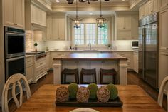 Inset, white kitchen, with lots of storage.  Wood top island seats all your friends and family.